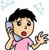 電話で謝罪するスタッフ